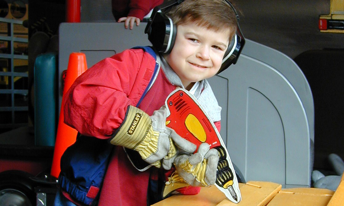 Boy playing with toy drill