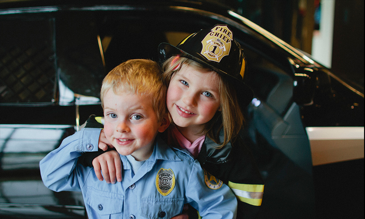 Brother and sister in police costumes in Emergency gallery