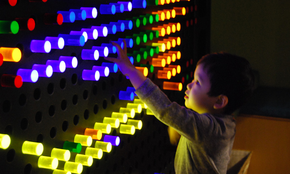 Boy playing with the giant lightbright in Emergency gallery