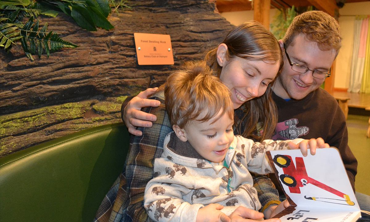 Family reading in the Forest gallery