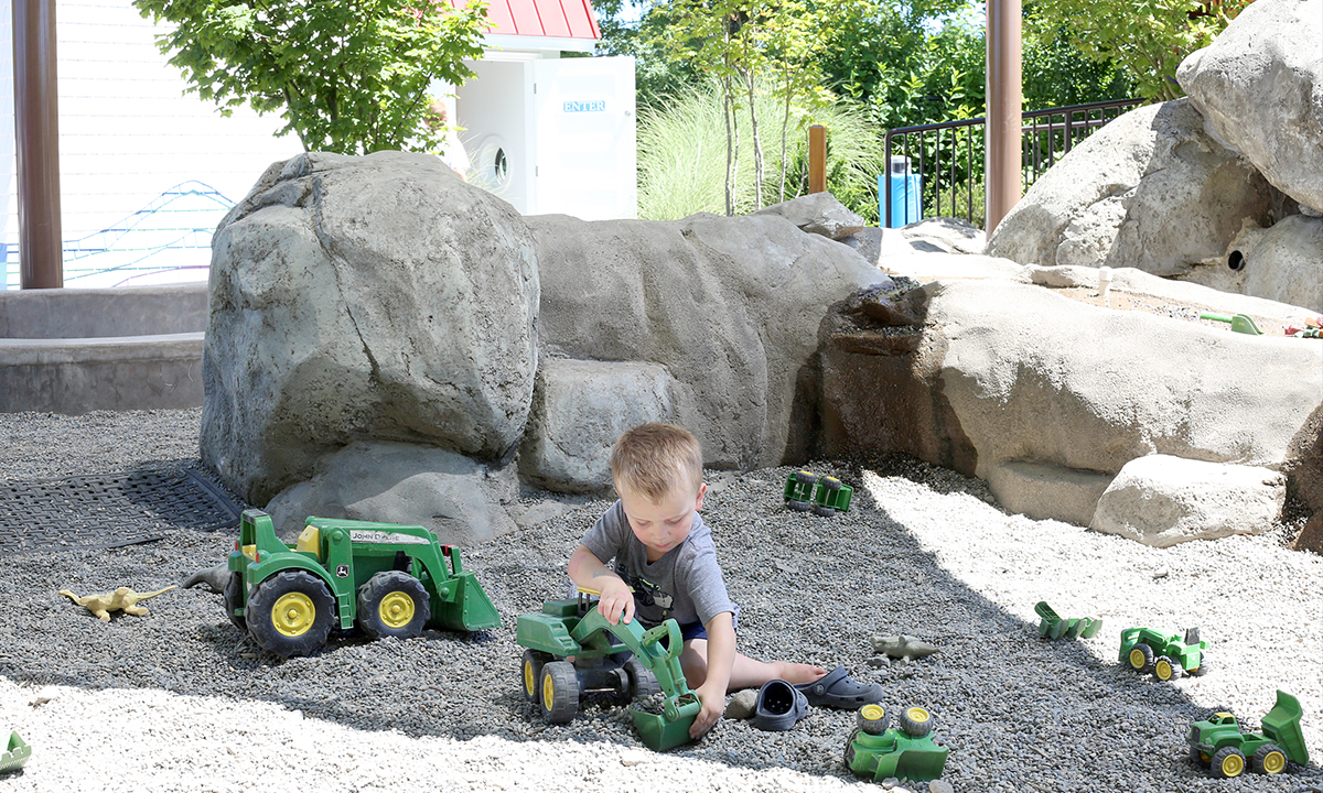 Boy playing in the gravel dig