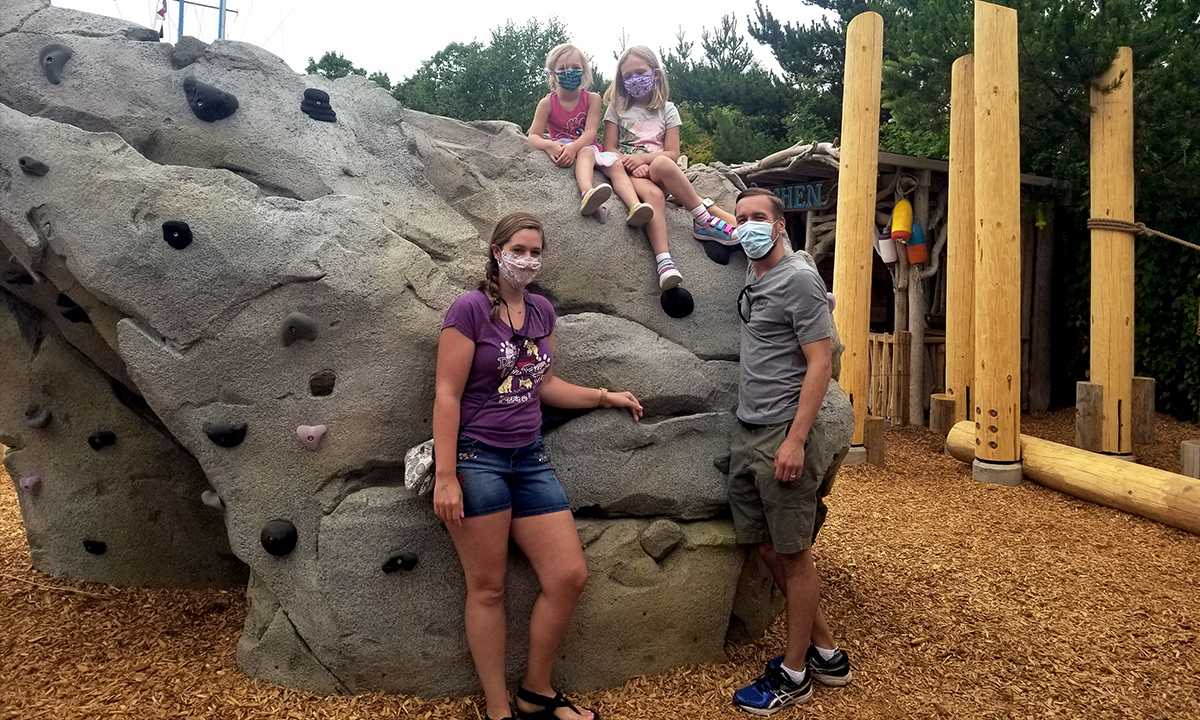 Family on the climbing boulder